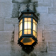 Vintage lantern on a stone wall of an old building - Stock Photo
