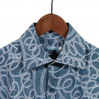 Stock Photo: Blue shirt on hanger