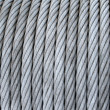 Steel cable on a coil - Stock Photo