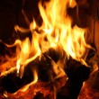 Flames dancing in fireplace - Stock Photo