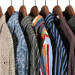 Colorful clothes on a rack — Stock Photo