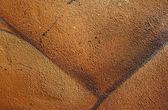 Textura granosa de un muro de hormigón pintado — Foto de Stock