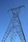 Silhouette of a high voltage electricity pylon — Stock Photo
