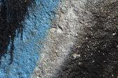 Détail des graffiti sur un mur de béton granuleux — Photo