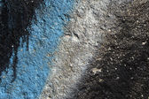 Graffiti-detail auf eine körnige betonwand — Stockfoto