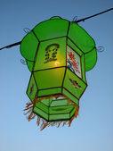 Cozy light of a green Chinese lantern — Stock Photo