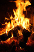 Flames dancing in fireplace — Stock Photo