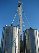 Steel grain bins and blue sky — Stock Photo