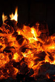Glowing coals in the fireplace — Stock Photo