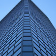 Angle view of a glass-windowed skyscraper — Stock Photo