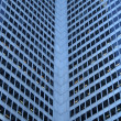 Stock Photo: Inside corner of a glass-windowed office tower