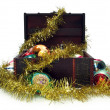 Treasure chest full of Christmas decorations - Stock Photo