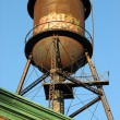 Stock Photo: Old water tower on the roof