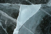 Triangular shape of a cracked ice — Stock Photo