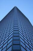 Angle view of a glass-windowed skyscraper — Stock Photo