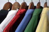 Man's clothing, choice of colorful shirts — Stock Photo