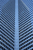 Inside corner of a glass-windowed office tower — Stock Photo