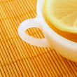 Teatime. Cup of tea with lemon — Stock Photo