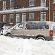 Stock Photo: Mshovelling after snow storm