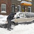 Stock Photo: Man shovelling and removing snow
