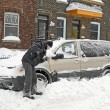 Man shovelling and removing snow — Stock Photo