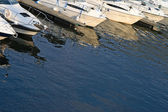 Motorboats reflections in water — Stock Photo