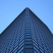 Angle view of a glass-windowed office tower - Stock Photo