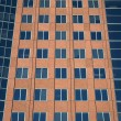 Stock Photo: Windows of terracotta-colored building