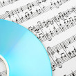 Blue CD and music notes - Stock Photo