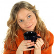 Charming girl with a big cup of tea - Stock Photo