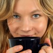 Charming young woman drinking tea - Stock Photo