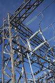 Metallic construction of high voltage electricity plant — Stock Photo