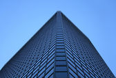 Angle view of a glass-windowed office tower — Stock Photo