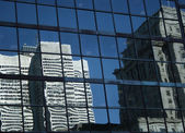 Reflections of modern buildings — Stock Photo
