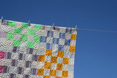 Patchwork counterpane on a clothes-line — Stock Photo
