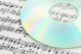 Audio CD and music notes — Stock Photo