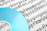 Blue CD and music notes — Stock Photo