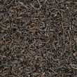 Black tea leaves background - Foto Stock