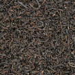 Black tea leaves background - Foto de Stock  