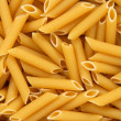 Penne rigate pasta background - Stock Photo