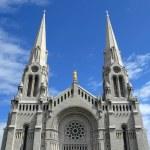 Catholic church against blue sky — Stock Photo #21909295