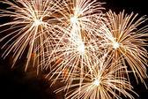 Golden firework bursts — Stock Photo