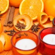 Candles, oranges and spices - Stock Photo