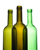 Three empty wine bottles for recycling — Stock Photo