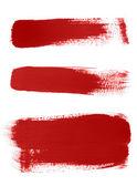 Red brush strokes on white background — Stock Photo