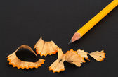 Sharpened pencil and wooden shavings — Stock Photo