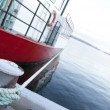 Red ship moored at a quay - Stock Photo