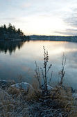 View over calm lake in sunset — Stock Photo