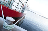 Red ship moored at a quay — Stock Photo