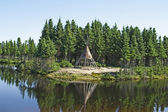 Native American tipi on a lakeshore — Stock Photo
